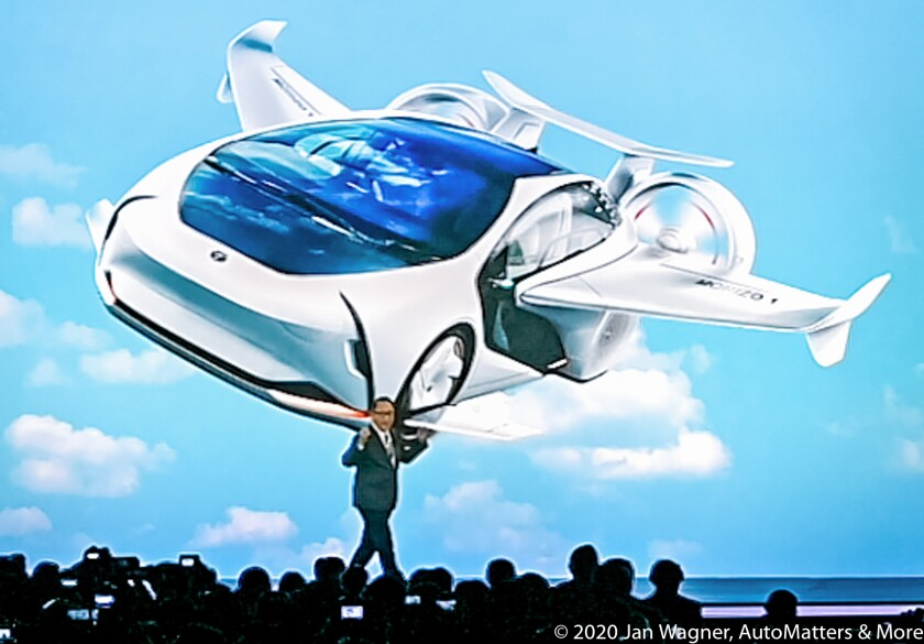 Toyota President & CEO Akio Toyoda with a future car concept.