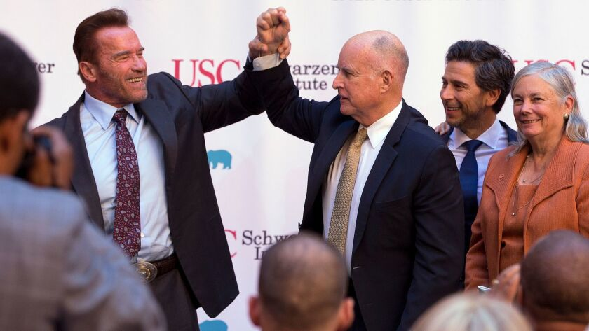 Former Govs. Arnold Schwarzenegger, left, and Jerry Brown.