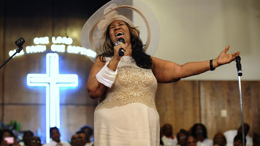 FILE - In this June 7, 2015 file photo, Aretha Franklin sings during a memorial service for her fath