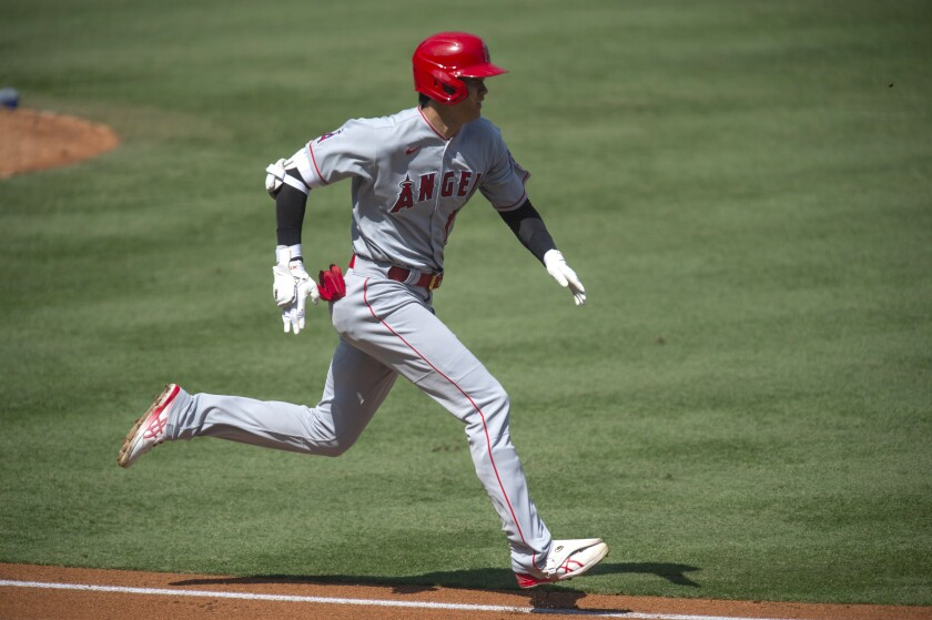 Los Angeles Angels' Shohei Ohtani sprints to first base for his infield single during the first inning of a baseball game against the Los Angeles Dodgers in Los Angeles, Sunday, Sept. 27, 2020. (AP Photo/Kyusung Gong)