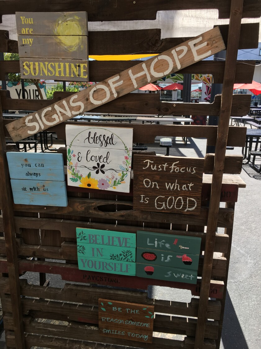 Signs of Hope, by wood working students at  Classical Academy in Escondido