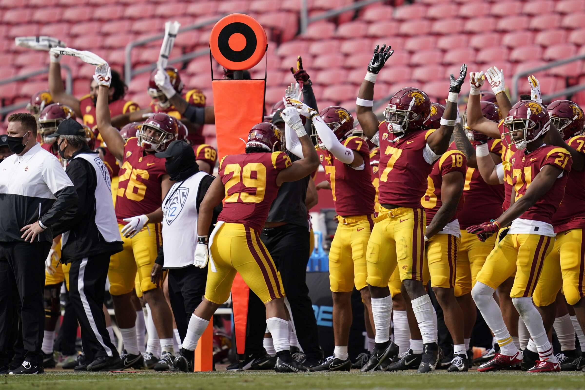 USC players celebrate on the sideline during the second half of the Trojans' 28-27 win over Arizona State on Saturday.