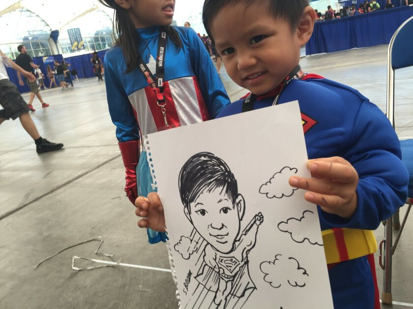 Union-Tribune editorial cartoonist Steve Breen sketches on of the best-dressed cosplayers at Comic-Con: Superman.