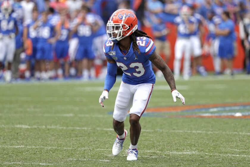 """FILE - In this Saturday, Sept. 21, 2019 file photo, Florida defensive back Jaydon Hill covers a play against Tennessee during the second half of an NCAA college football game in Gainesville, Fla. Florida cornerback and projected starter Jaydon Hill will miss the season after tearing the anterior cruciate ligament in his left knee, an injury coach Dan Mullen called a """"massive disappointment."""" (AP Photo/John Raoux, File)"""