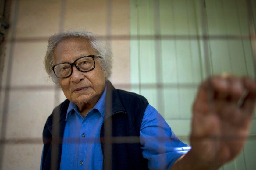 In this Oct. 24, 2013 photo, Win Tin, a former political prisoner and an opposition party stalwart poses for a picture at his home in Yangon, Myanmar. Win Tin, a prominent journalist who became Myanmar's longest-serving political prisoner after challenging military rule by co-founding the National