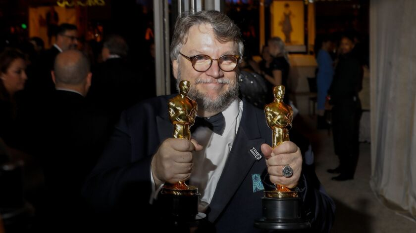 """HOLLYWOOD, CA - March 4, 2018--""""The Shape of Water"""" director Guillermo del Toro with his Oscars for"""