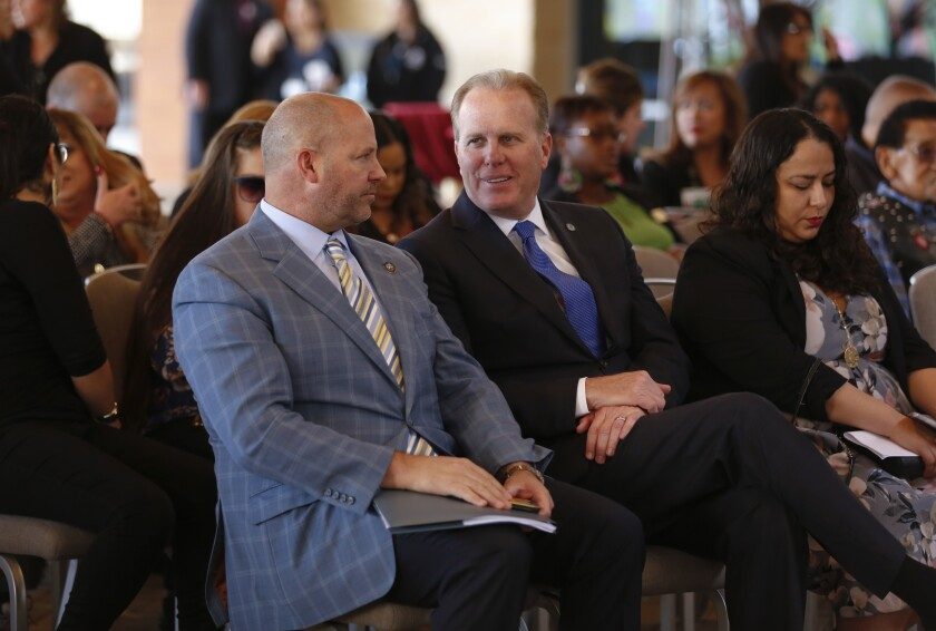 San Diego mayor Kevin Faulconer (right) and Adam Day, chief administrative officer for the Sycuan Band of the Kumeyaay Nation,  chatted during the opening ceremony Tuesday for the new Sycuan Casino Resort.