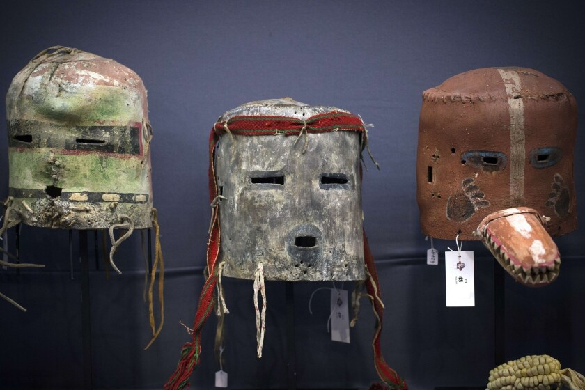 A view of three Hopi masks from Arizona during a Paris auction of sacred objects from the Hopi and San Carlos Apache Native American tribes.