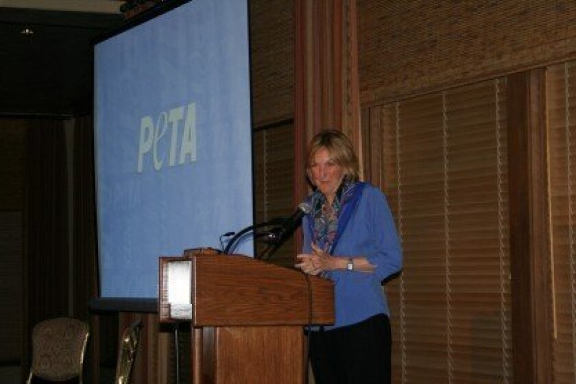 """Ingrid Newkirk, PETA's co-founder and president, encourages people to fight for animal rights during """"The Naked Truth: An Animal Right Radical at Large"""" event Feb. 6 at the Del Mar Country Club in Rancho Santa Fe. Photo/Kristina Houck"""