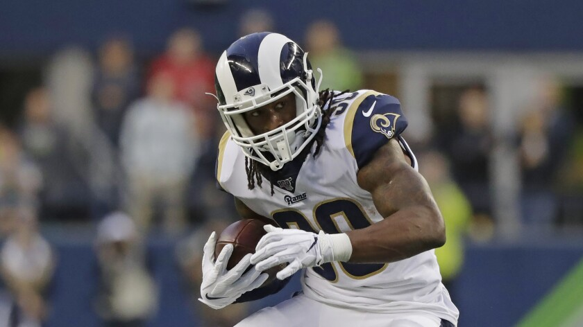 Rams running back Todd Gurley carries the ball during a game against the Seattle Seahawks on Oct. 3, 2019, in Seattle.