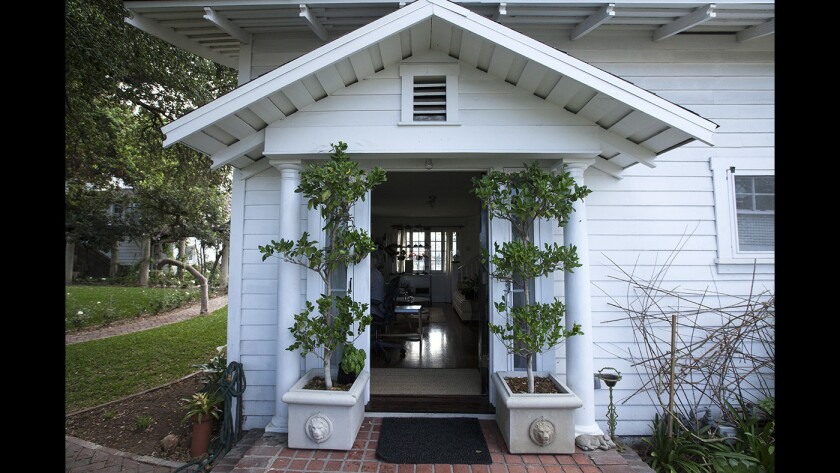 A covered front porch at Tamra Fago's tiny house in Garvanza, one of Los Angeles's oldest neighborhoods. Her home is one of three recently revived historic rentals within the 3,600-square foot Dr. John Lawrence Smith property from 1886, restored by preservationist Brad Chambers in 2013.