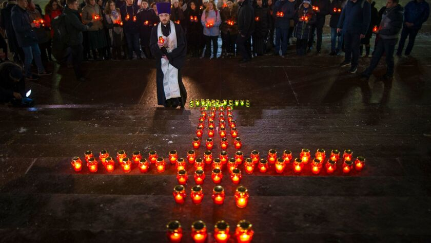 Orthodox youth with a priest gather at the Cathedral of Christ the Saviour in Moscow lighting 71 can