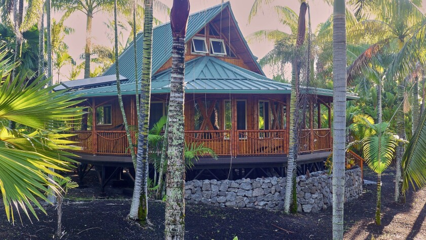 A blue-roofed cottage built of quick-growing bamboo awaits guests at Kipuka, an off-the-grid collection of four guest homes near the eastern tip of Hawaii Island.