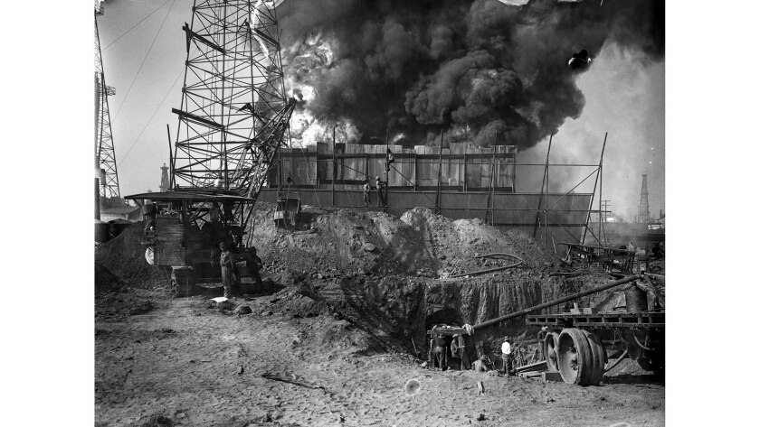June 1929: Workers dig a tunnel in an effort to cap the burning McKeon oil well behind them in Santa