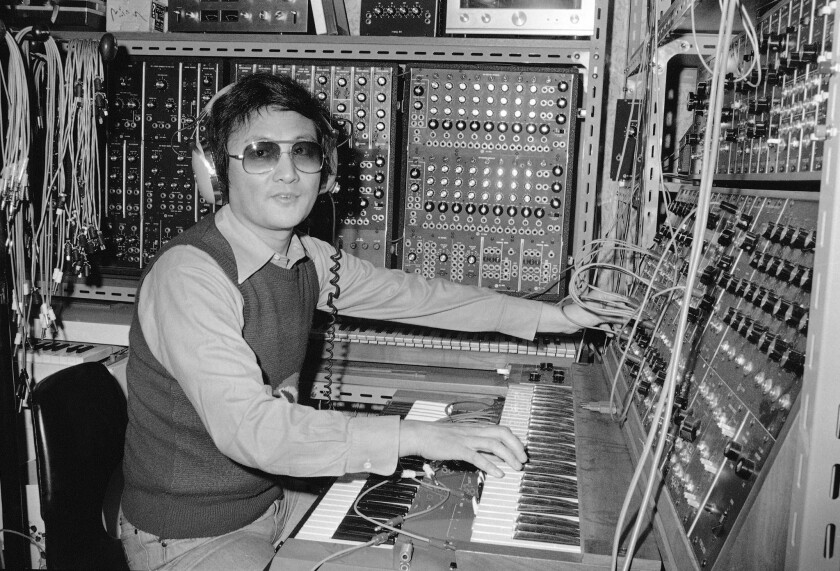 A one-man orchestra, Isao Tomita makes electronic music in his component-filled studio in Tokyo, June 30, 1976.