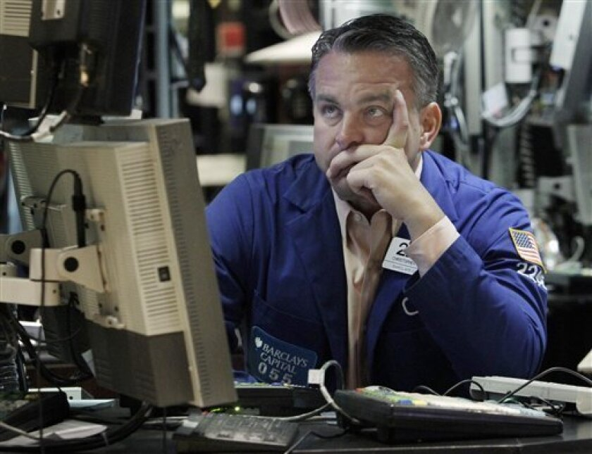 FILE - In this June 3, 2011 file photo, specialist Christopher Culhane works at his post on the floor of the New York Stock Exchange. Global stocks recovered Tuesday, June 7, after another big sell-off on Wall Street, as investors awaited a key speech from U.S. Federal Reserve chairman Ben Bernanke following a run of weak economic news. (AP Photo/Richard Drew, file)