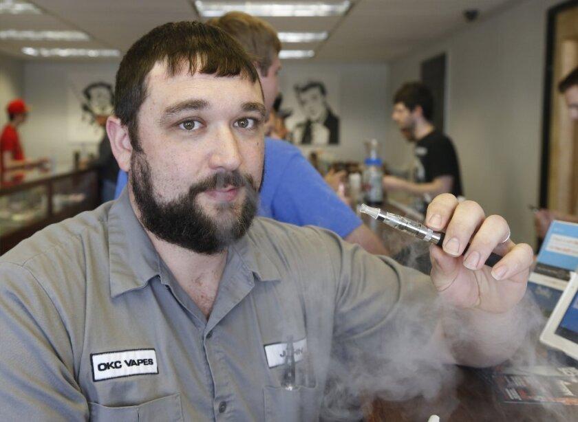 Marlboro maker Altria plans electronic cigarette as sales drop
