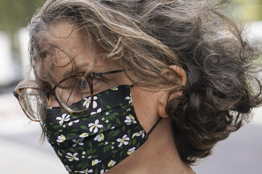 Clare Bronfman arrives at federal court, Wednesday, Sept. 30, 2020, in the Brooklyn borough of New York. Bronfman, the Seagram's liquor fortune heir and a wealthy benefactor of Keith Raniere, the disgraced leader of a self-improvement group NXIVM in upstate New York convicted of turning women into sex slaves who were branded with his initials, faces sentencing Wednesday in the federal conspiracy case. (AP Photo/John Minchillo)