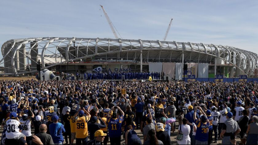 Fans gather at the Rams' future home in Inglewood to send the team off to Super Bowl LIII on Jan. 27.