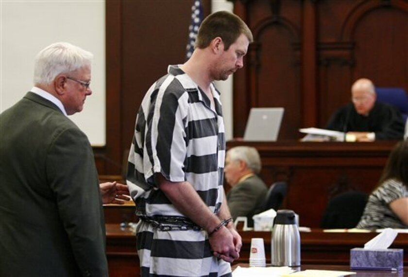 Former NFL quarterback Ryan Leaf, center, appeared before district judge Kenneth Neill, right, during a hearing in a Cascade County courtroom, Tuesday, May 8, 2012, in Great Falls, Mont. Leaf pleaded guilty Tuesday to charges that he broke into a Montana home and illegally possessed painkillers, pa
