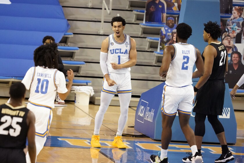 UCLA guard Jules Bernard (1) celebrates after scoring against Colorado during the first half Jan. 2, 2021, in Los Angeles.