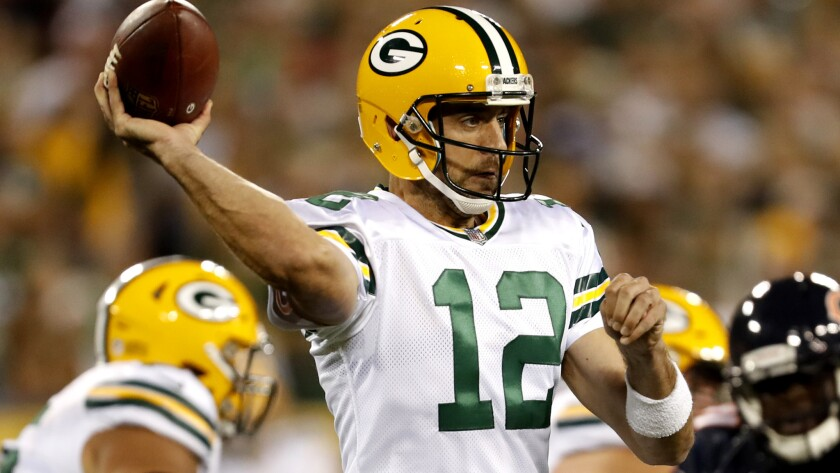 Green Bay Packers' Aaron Rodgers throws during the first half of an NFL football game against the Ch