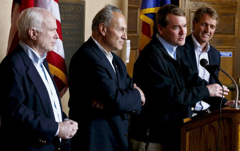 Immigration reform advocates Sen. Michael Bennett (D-Colo.) speaks alongside Sen. John McCain (R-Ariz.), Sen. Chuck Schumer (D-N.Y.) and Sen. Jeff Flake (R-Ariz.)
