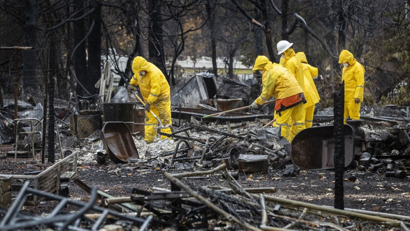 PARADISE, CA - NOVEMBER 23, 2018: As rain continues to fall, search and rescue teams sift through th