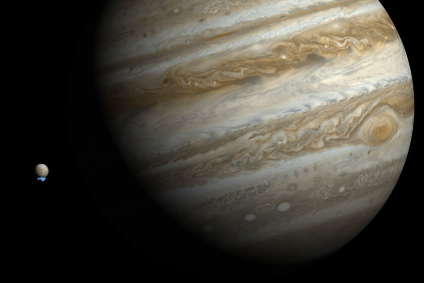 An artist's impression shows Jupiter's icy moon Europa shooting plumes of water vapor from around its south pole.