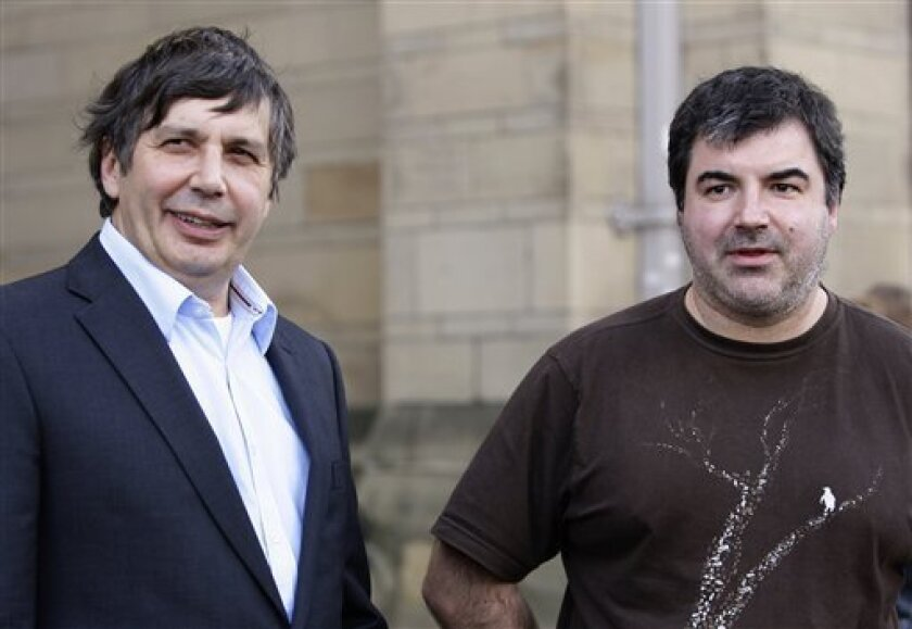FILE - This is a Tuesday, Oct. 5, 2010 file photo of Professor Andre Geim, left, and Dr Konstantin Novoselov are seen outside Manchester University, Manchester, England. The scientists won the 2010 Nobel Prize for Physics. (AP Photo/Jon Super, File)