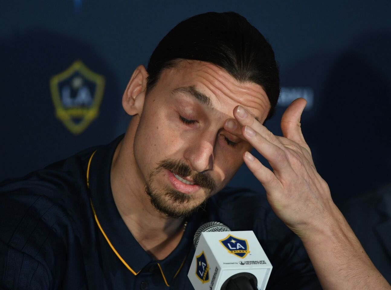 LA Galaxy footballer Zlatan Ibrahimovic gestures during his first press conference for the club in Los Angeles, California, on March 30, 2018. The 36-year-old Swedish striker's move to MLS from Manchester United was confirmed last week, with Ibrahimovic swiftly vowing to reignite the Galaxy's fortunes after they finished bottom of the league last season. / AFP PHOTO / Mark RalstonMARK RALSTON/AFP/Getty Images ** OUTS - ELSENT, FPG, CM - OUTS * NM, PH, VA if sourced by CT, LA or MoD **
