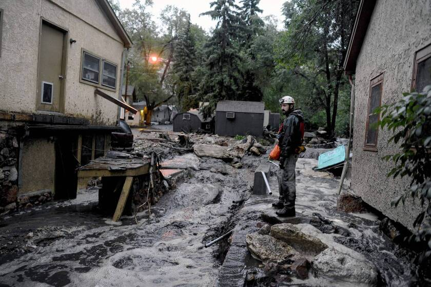 Volunteer rescuer Jesse Rochette searches for anyone trapped or stranded during flash-flooding Aug. 9 in Manitou Springs, Colo. The town has been hit by flooding four times since July 1.