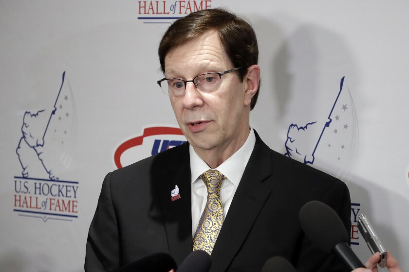 FILE - Nashville Predators general manager David Poile answers questions before being inducted into the U.S. Hockey Hall of Fame in Nashville, in this Wednesday, Dec. 12, 2018, file photo. Just three seasons removed from hoisting the Presidents' Trophy, the Predators find themselves on the verge of rebuilding. The only question is when does the NHL's winningest general manager start tearing down what he's built. David Poile says he wants to see how the Predators fare over a stretch against the Central Division's best. (AP Photo/Mark Humphrey, File)