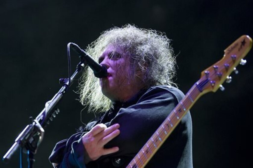 FILE - In this July 14, 2012 file photo, Robert Smith, frontman of English rock band The Cure, performs during the group's concert at the Optimus Alive music festival in Lisbon, Portugal. The Cure will embark on a 22-city North American tour in 2016. (AP Photo/Armando Franca, File) EDITORIAL USE ONLY