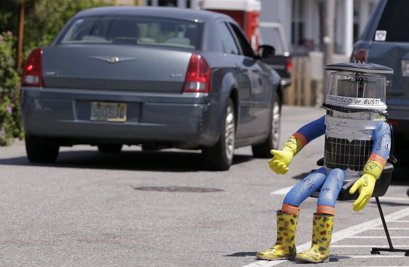 Hitchbot, a hitchhiking robot, is seen in Marblehead, Mass., on July 17. This week, as it continued its journey, the robot was damaged beyond repair in Philadelphia.