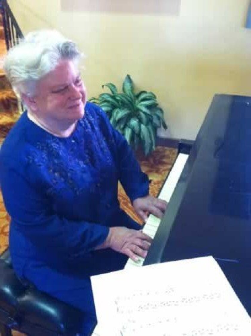 Leslie Miller at the piano. Brianna Alexander