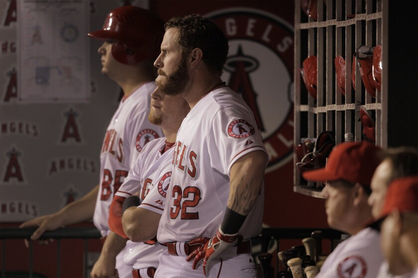 Angels left fielder Josh Hamilton (32) watches from the dugout during a game against the Seattle Mariners on Sept. 16.