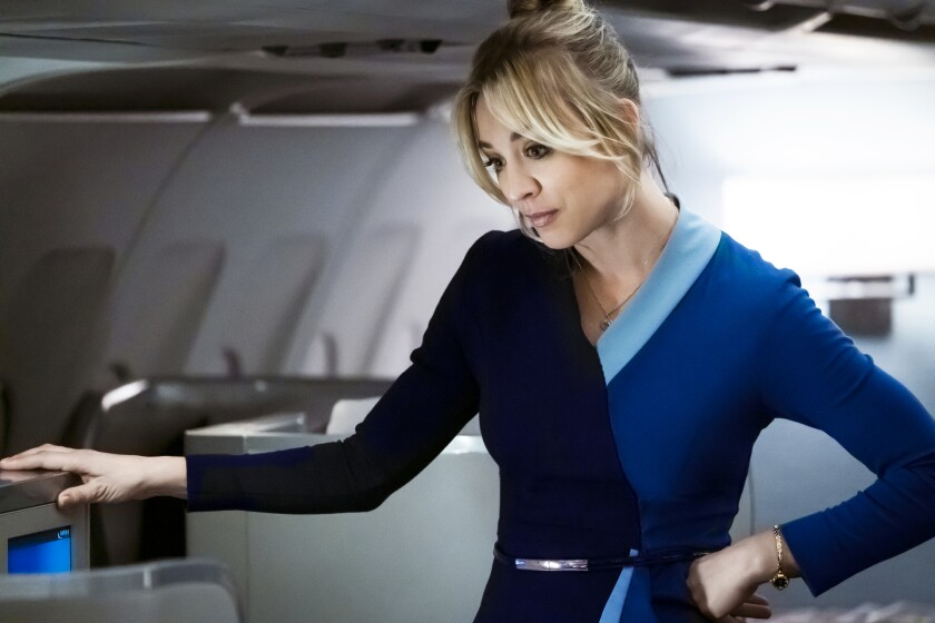"""Kaley Cuoco in an airplane in a scene from her first big post-""""Big Bang Theory"""" success """"The Flight Attendant."""""""