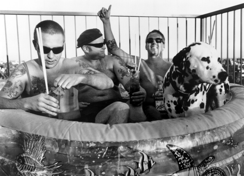 "Band members Bud Gaugh (left), Eric Wilson and Brad Nowell of Sublime live it up in Long Beach in this 1995 photo. To commemorate the 20th anniversary of the band's ""40 oz. to Freedom"" album, the remaining band members are collaborating on a beer with San Diego brewery Alesmith. (John Dunne for the Los Angeles Times)"