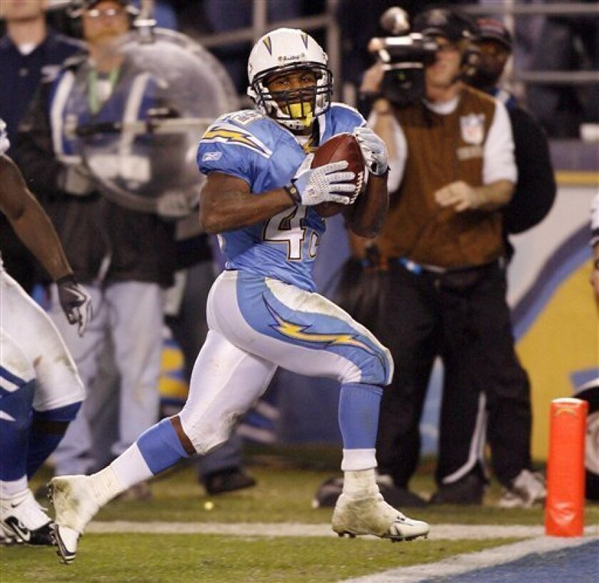 In this Jan. 3, 2009 file photo, San Diego Chargers running back Darren Sproles scores the winning touch down in overtime during an NFL AFC wild-card playoff football game in San Diego. Sproles isn't all that comfortable dealing with the media. But he figures it's like carrying the ball _ the more