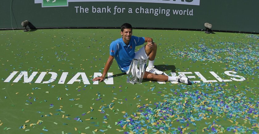 Novak Djokovic, of Serbia, poses on the court after defeating Milos Raonic, of Canada, in a final at the BNP Paribas Open tennis tournament, Sunday, March 20, 2016, in Indian Wells, Calif. Djokovic won 6-2, 6-0. AP Photo/Mark J. Terrill)