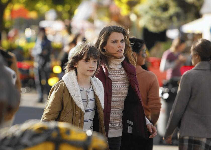 "Keidrich Sellati and Keri Russell star in ""The Americans."""