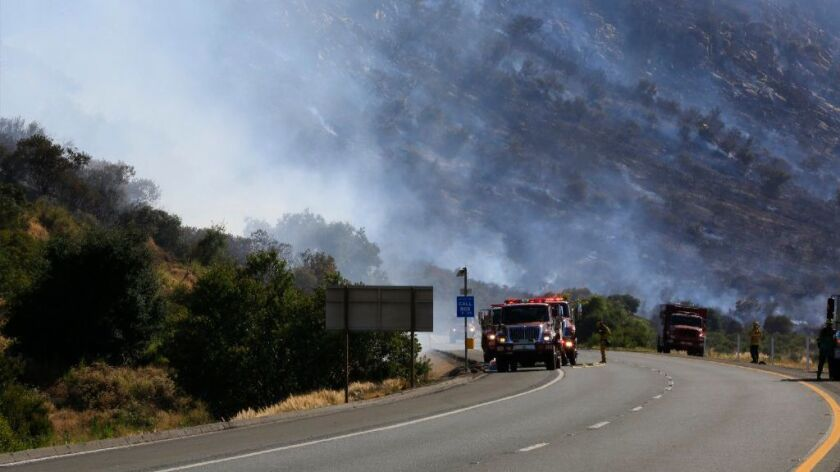 Firefighters positioned themselves on east Interstate 8, just west of Dunbar Lane where a brush fire