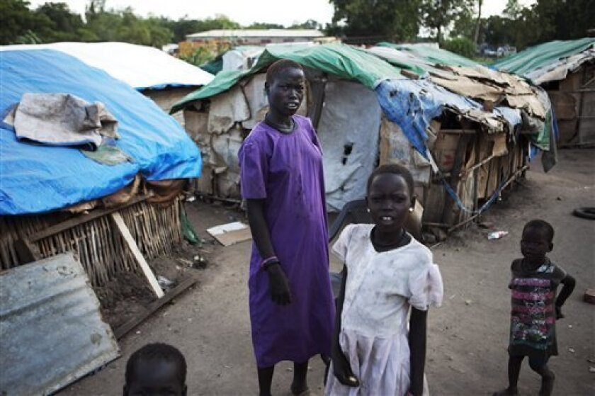 Women of the Mundari tribe stand outside their makeshift homes in Juba, southern Sudan, Wednesday, Aug. 18, 2010. The population of the defacto southern capital swelled considerably in recent years as those seeking employment or fleeing conflict and instability relocated to the city. Many set up sh