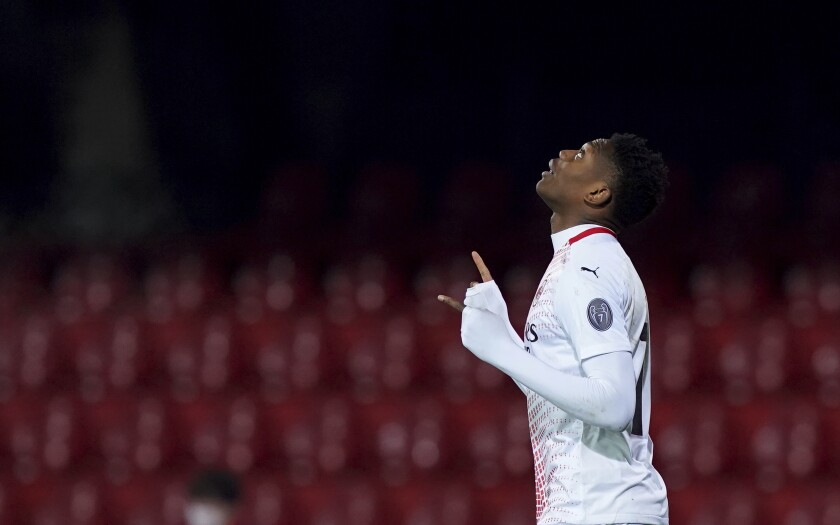 Milan's Rafael Leao celebrates after scoring his side's second goal during the Italian Serie A soccer match between Benevento and Milan at the Vigorito stadium in Benevento, Italy, Sunday, Jan. 3, 2021. (Spada/LaPresse via AP)