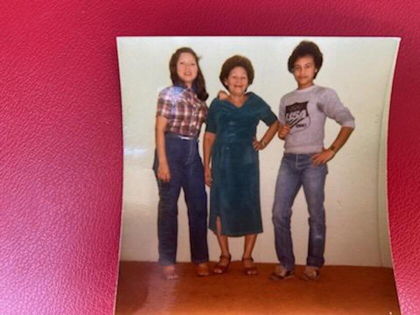 Carlos Ernesto Escobar Mejia with his sister Rosa and their mother