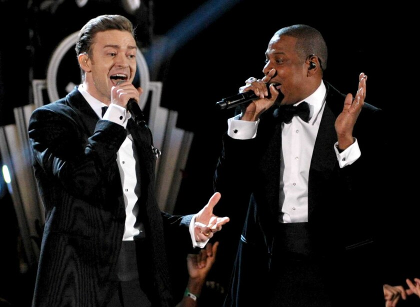 Recording artists Justin Timberlake, left, and Jay-Z, shown performing Feb. 10 at the Grammy Awards in Los Angeles, will play a dozen stadium shows this summer.