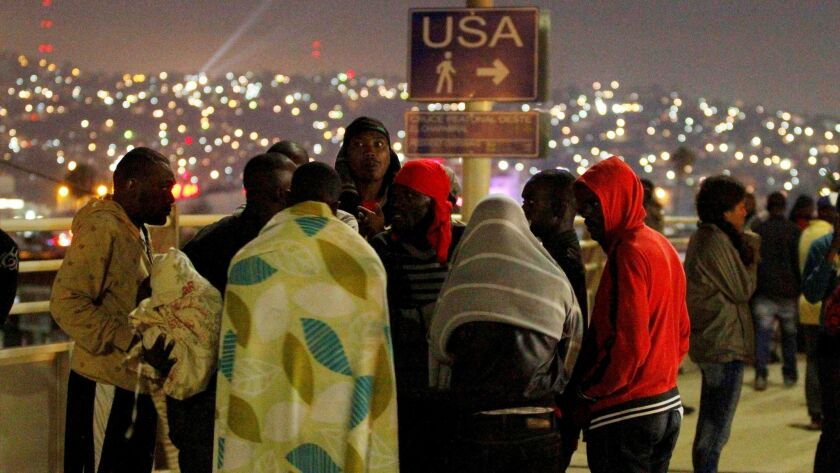 Haitians migrants wait to make their way to the U.S.at the San Ysidro Port of Entry in Tijuana, Mexico, July 15, 2016. REUTERS/Jorge Duenes
