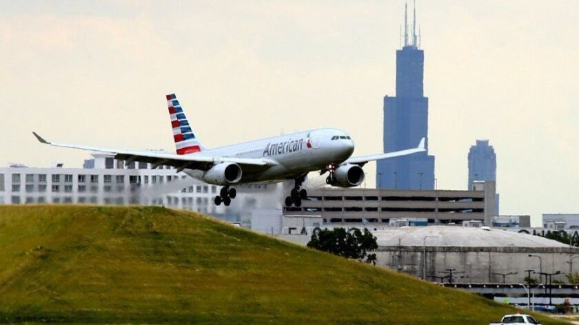 An American Airlines jet prepares to land at Chicago's O'Hare International Airport in 2016. The airline reported Oct. 25, 2018, that rising fuel cost have cut its profit nearly in half, and the airline says it will reduce its planned growth and cancel unprofitable flights.