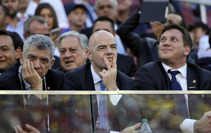 FIFA President Gianni Infantino, center, watches the opening ceremony of the Copa America Centenario at Levi's Stadium in Santa Clara, Calif., Friday, June 3, 2016. (AP Photo/Jeff Chiu)